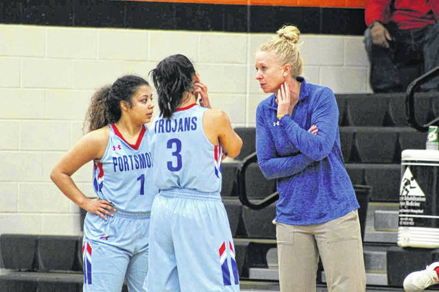 Portsmouth head coach Amy Hughes talks to her Jasmine Eley and Nia Trinidad in the Trojans road win over White Oak.