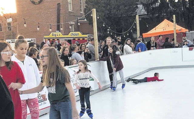 With one exception, skaters make their way around the temporary ice rink on Market Square.