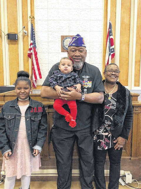 Commission member Lee Bass with his wife Donna and two granddaughters Judah and Malala.