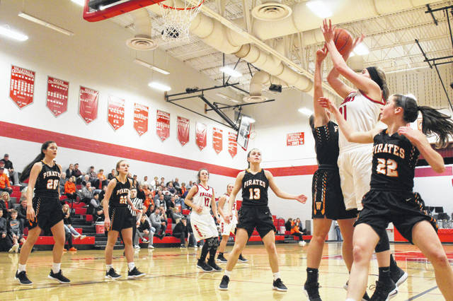 Minford's Ashley Blankenship shoots over Wheelersburg's Ellie Kallner during the Pirates' 55-42 win over the Falcons on Jan. 3, 2019.