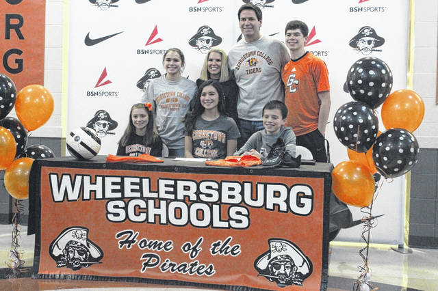 Wheelersburg senior Libby Miller signed her LOI with Georgetown College (Ky.) to play soccer at run track for the Tigers.