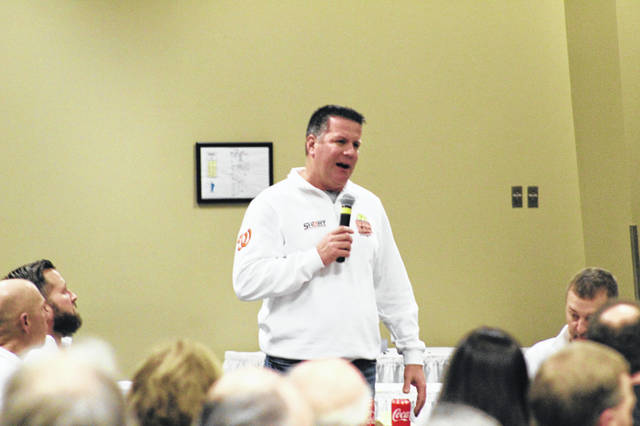 Wheelersburg LL softball head coach Dusty Salyers addressing the crowd at the Fifteenth Annual Portsmouth Murals Baseball Banquet Wednesday night.