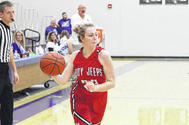 South Webster senior Taylor Rawlins attempts a post entry pass in the Jeeps road win over Valley on Thursday.