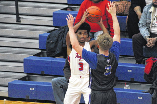 Portsmouth senior Danny Lattimore attempts to inbound the ball in the Trojans home loss to Gallia Academy on Tuesday.