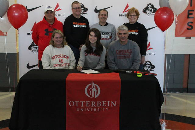 Wheelersburg senior Lea Wright signed her letter of intent to play tennis for Otterbein University at her signing ceremony at Wheelersburg High School Wednesday afternoon. She is joined by Tom Carter (far left), Brian Jackson (center left), BJ Lehoist (center right), and Becky Jackson (far right), as well as parents Jodi and Larry Wright.