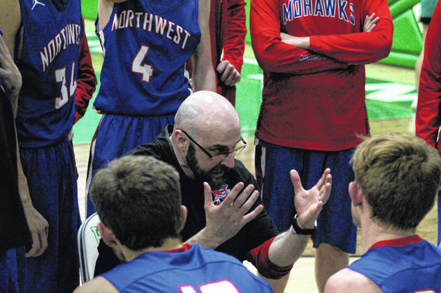Northwest coach Jason Smith talks to his team in a timeout during Tuesday's 55-40 loss at Huntington Ross.