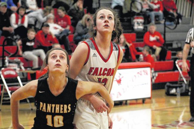 Minford's Caitlyn Puckett is boxed out by Miami Trace's Shaylee McDonald during the Panthers' 54-45 win over the Falcons Monday evening.