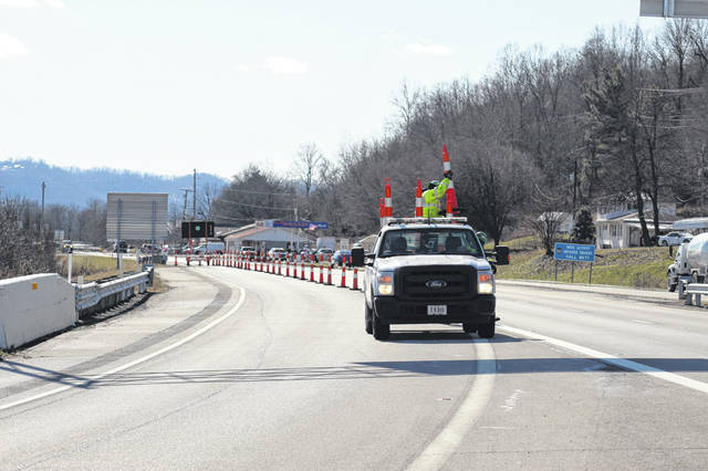 Workers with the Ohio Department of Transportation began closing the exit to West Portsmouth off US 52 East Friday afternoon as the Scioto River continued to rise.