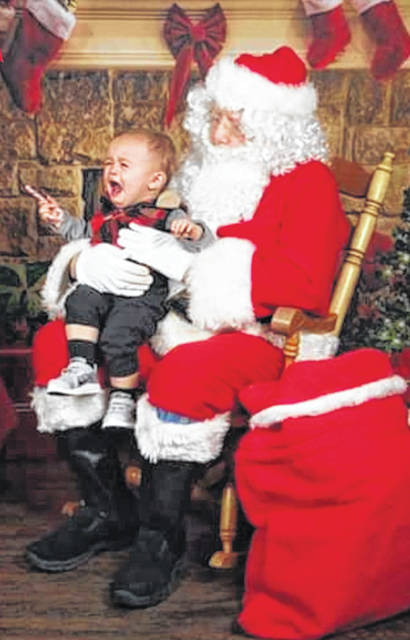 The photo submitted by Angela Ruggles of her grandson won second place in the Scared Santa contest.