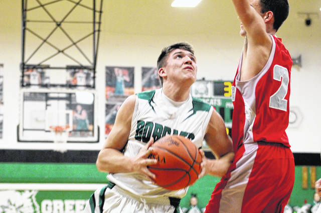 Green's Gage Sampson drives to the basket during the first half of Friday's 90-46 win over Symmes Valley.
