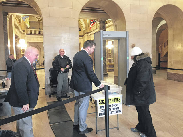 Scioto County Courthouse security officials Eric Valentine, Denver Triggs and Craig McLaughlin are busy checking individuals as they enter the courthouse.