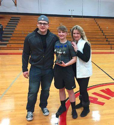 Green senior Hailey Hammond (center) poses for a photo with coach Austin Gifford (left) and mother Aroma Gifford (right).