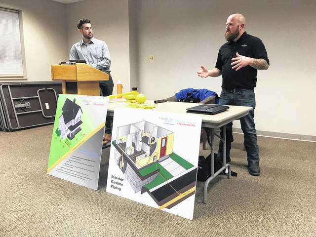 (Left to right) Representatives from Columbia Gas of Ohio, Luka Papalko and Corey Newsome spoke with customers who would be impacted by the replacement line project.