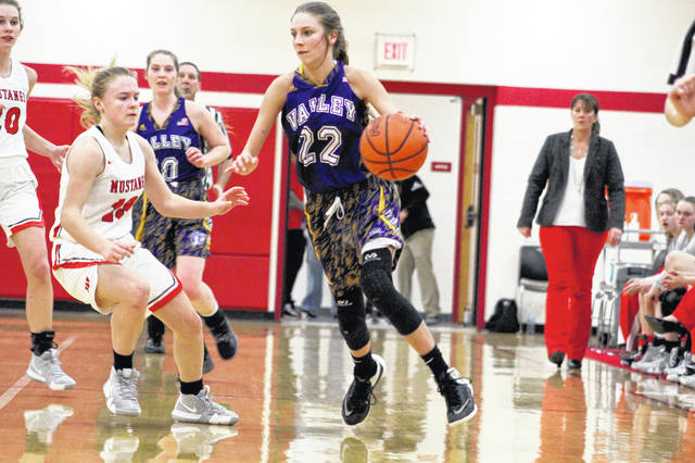 Valley's Karsyn Conaway scored 11 of her 13 points during the first quarter of Wednesday's 55-43 win over Westfall in a Division III sectional semifinal Jackson High School.