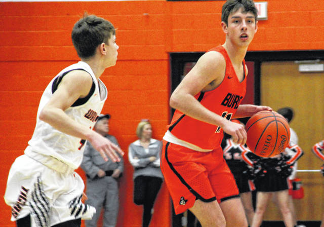 Wheelersburg's Dustin Darnell looks for an open teammate during the first half of Friday's 69-46 win at Waverly.