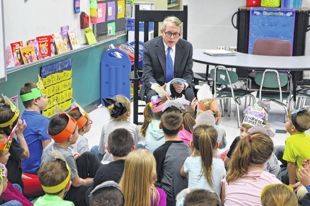 Ohio Governor Mike DeWine reading to the first grade students.