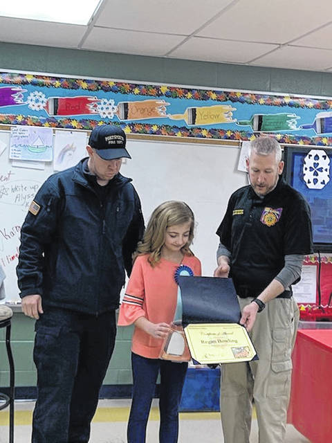 Presenting the award:( l to r)Micahel Sines-Portsmouth Fire Prevention Officer, Reagan Bowling-State Poster Winner, and Paul Martin State Fire Prevention Officer
