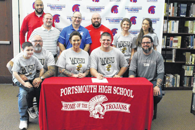 Portsmouth senior Colin Boehm signed his letter of intent to play football at West Virginia State University at his signing ceremony Wednesday afternoon.