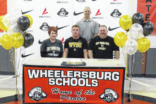 Wheelersburg senior Tanner Wilson signed his letter of intent with West Virgnia State University Wednesday everning at his signing ceremony at Wheelersburg High School.