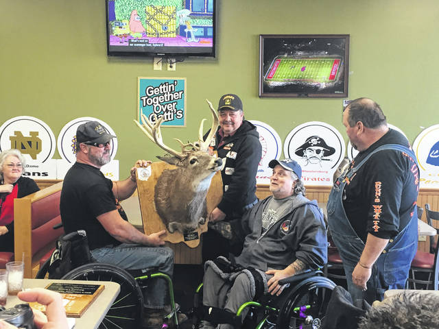 United States Navy Veteran Ron Wood, Second from right, receives his No Kill Deer Hunt trophy. Also pictured in the presentation are from left, United States Army Veterans Rick Bell and Mike Bell and No Kill Deer Hunt organizer Todd Dunn.