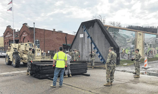 Called in to help avert disaster, the Ohio National Guard aided with the first erection of the city's flood gates in 20 years in February 2018.