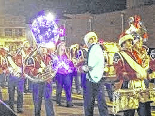 An unidentified band marches in a recent Portsmouth Jaycees Christmas parade.