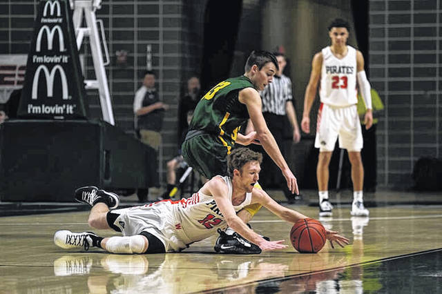 Wheelersburg senior Connor Mullins dives for a loose ball in the Pirates 58-39 win over North Adams.