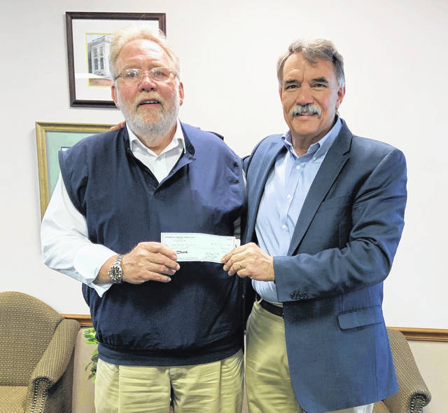 From Left-Bill Carson from the Portsmouth Elks Lodge BPOE No. 154., presenting a check to Mark Hunter for the Steven Hunter Hope Fund.