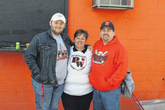 Andy and Alec Arnett pose with Portsmouth West softball coach Dani Coleman at Saturday's super scrimmage for area softball teams while helping raise money for the Angela Arnett Memorial Scholarship fund for Portsmouth West students.