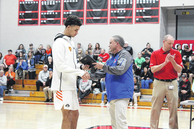 Wheelersburg senior Tanner Holden receives his SOC II player of the year plaque.