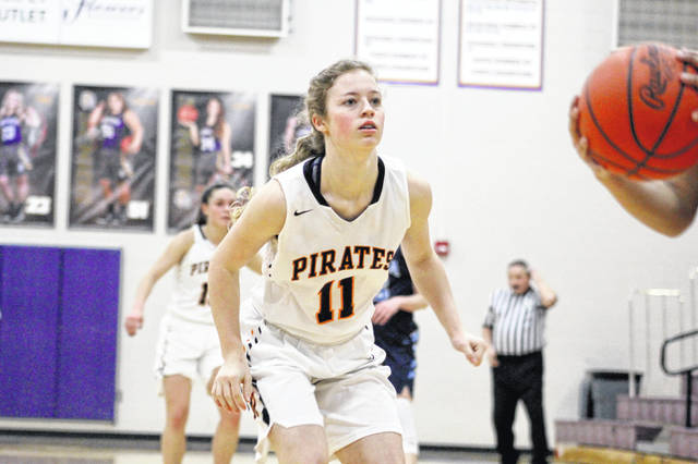 Wheelersburg sophomore Lauren Jolly is motivated by seniors Abbie Kallner and Karlie Estep to advance as far as possible in the Division III girls' basketball tournament.