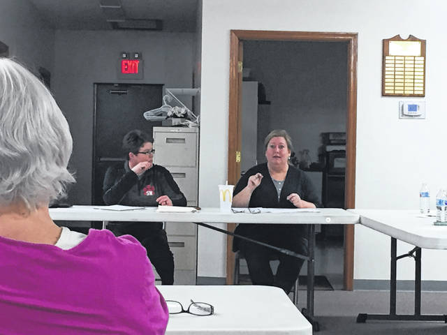 South Webster Village Clerk Krystal Hill looks on as Mayor Maribeth Dalton speaks to a crowd Monday night about the proposed sale of the South Webster Senior Center building.
