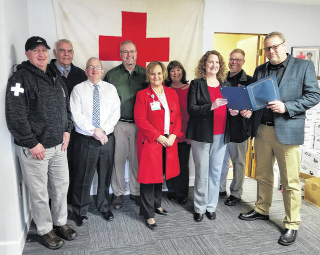 Debbie Smith from the local Red Cross office receiving the proclamation from Portsmouth Mayor Kevin E. Johnson, along with members of the Red Cross office.