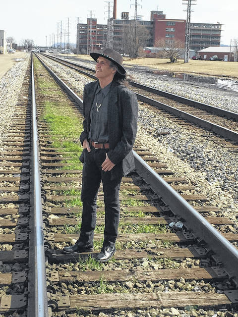 Steve Free, posing on the railroad tracks in Portsmouth. Free has been awarded Best Folk Artist by a British magazine.