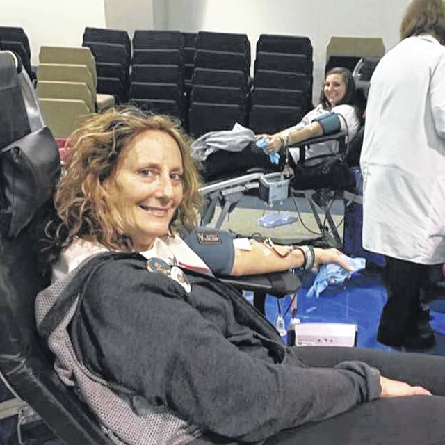 Storm's mother, Lynn Bratchett and his sister, Rachel Irwin giving blood in honor of Storm at one of the past blood drives.