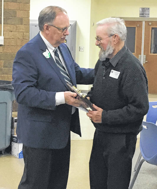 Valley School Board Member, Carl W. Crabtree receiving his award from the Ohio School Boards Association's Southeast Region. Left to Right: Paul Mock - Regional Director of OSBA and Carl Crabtree Valley School Board.