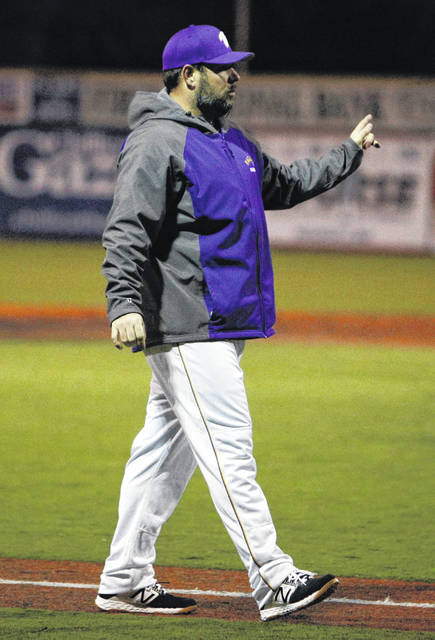 Valley coach Nolan Crabtree discusses a lineup change during Monday's 5-0 loss to Piketon at VA Memorial Stadium.