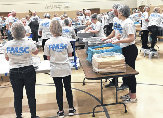 Over 100 volunteers packed into the gym at Portsmouth's Cornerstone Church for on one of three food packing sessions to aid Feed My Starving Children.