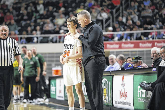 Wheelersburg head coach Steven Ater instructs sophomore Aaron Jolly during the Pirates district semifinal win over North Adams last Saturday night.