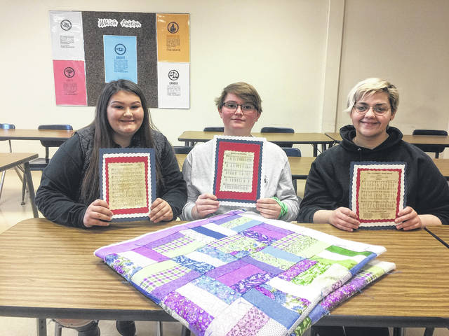 Left to right: Kasey Johnson, Gracey Miller, and Micaela Palmer, the three girls from the SCCTC with their quilt, as part of their competition in the American Spirit Contest in Columbus.
