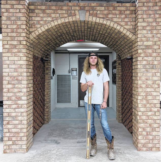 Eli Webb from the Scioto County Career and Technical Center (SCCTC) in front of an entrance he helped build.
