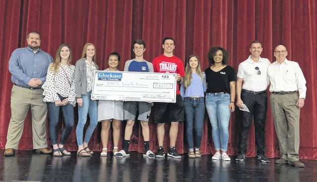 Left to right: Nate Kline-teacher, Jaiden Rickett, Lauren Albrecht, Luke Rodbell, Aiden Donges, Autumn Wright, Chole Minton, Emily Jones, Tim Glockner, and Mike Thompson standing with the check from the Dare to Dream Project.