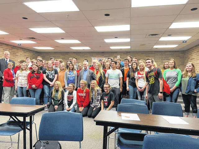Students of South Webster having their photo taken with Representative Bill Johnson. (Johnson center, Left Front- Brett Roberts-South Webster High School Principal and Cindi Hykes - Teacher).