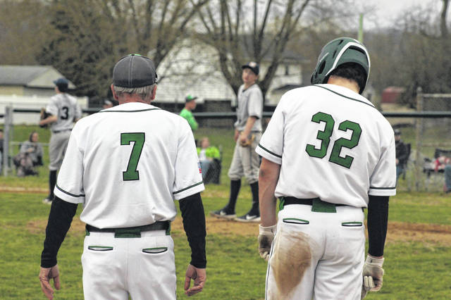 Green senior Tayte Carver allowed just one hit in the Bobcats 11-0 win over Notre Dame Friday night. Green senior Bryce Ponn stands beside head coach Danny McDavid after his bases clearing three RBI triple in the Bobcats win over Notre Dame Friday night.