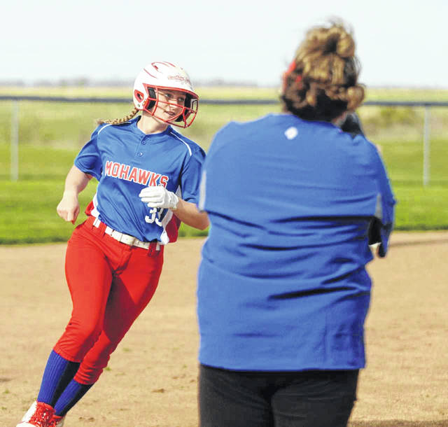 Northwest's Jaclyn Burchett rounds third base after hitting her first of two home runs Tuesday night at Frankfort Adena.