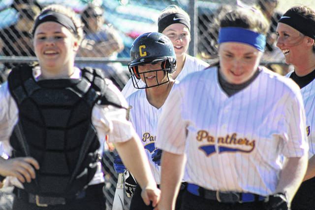 Clay's Cassidy Wells heads to the dugout after hitting a home run in the second inning of Tuesday's 7-4 loss to Waverly.