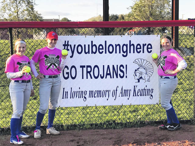 "(L-R) Portsmouth's Olivia Ramey, Maddison Perry, and Cassie Potts each went yard in the Trojans' 9-0 win over Rock Hill Monday. Monday's win also happened to be Portsmouth's ""Strikeout cancer"" game in memory of Amy Keating, a Portsmouth High School teacher who passed away in February after a battle with cancer."