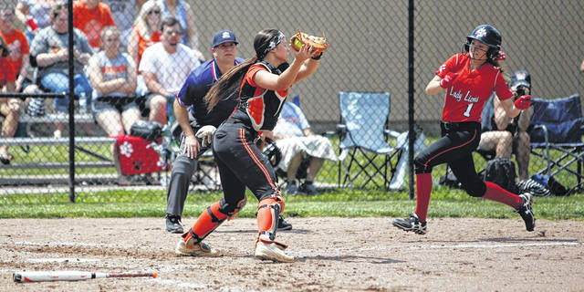 Wheelersburg catcher Addi Collins gets ready to tag out a runner at home plate during the Pirates' 8-5 loss to Leesburg Fairfield in a Division III district championship, Saturday at Unioto High School.