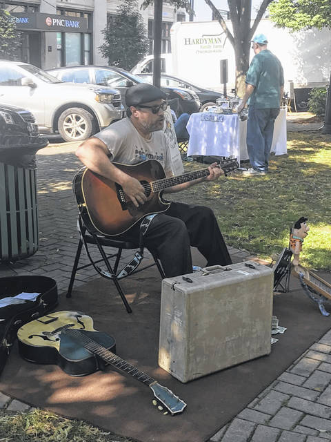 Johnny Whisman provided live music to shoppers and vendors.
