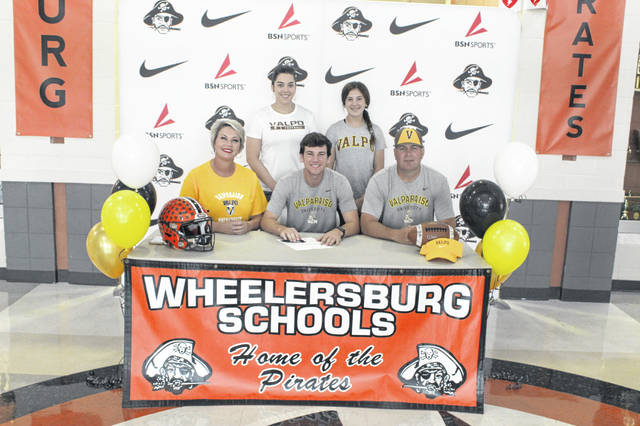 Wheelersburg senior Trent Salyers signed his letter of intent to join the Valparaiso University football team this fall.